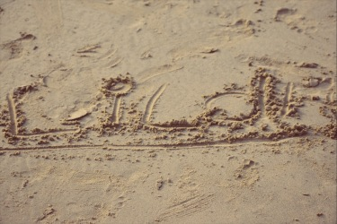 Lilah wrote her name in the sand